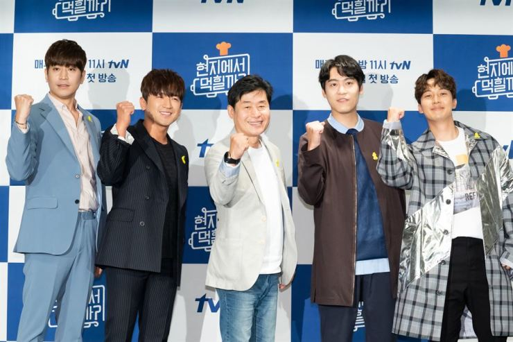 From left are Shinhwa's Eric, Lee Min-woo, chef Lee Yeon-bok, singer John Park and comedian Heo Kyung-hwan, who star in the third season of tvN's cooking reality show '4 Wheeled Restaurant.' Courtesy of tvN