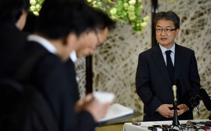 In this file photo taken on April 25, 2017, Joseph Yun (R), US special representative for North Korea policy, answers questions from reporters following a meeting with Japanese and South Korean chief nuclear negotiators at the Iikura Guesthouse in Tokyo. Yun confirmed on April 29 that North Korea asked for $2 million to release an American student who had fallen into a coma after alleged torture and said Washington should pay it. Joseph Yun, who had flown to Pyongyang in 2017 to bring back 22-year-old Otto Warmbier, said that North Korea presented him with a bill for his medical expenses. AFP