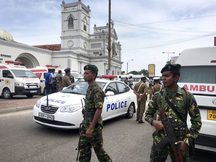 Sri Lankan Army soldiers secure the area around a church after a blast in Colombo, Sri Lanka, April 21. Witnesses are reporting two explosions have hit two churches in Sri Lanka on Easter Sunday, causing casualties among worshippers. AP