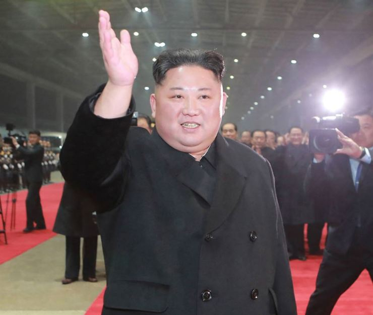 North Korean leader Kim Jong-un waves at Pyongyang Station, March 5, after traveling a day-and-a-half by train from Vietnam, where his high-stakes nuclear summit with President Donald Trump ended without any agreement. AP-Yonhap