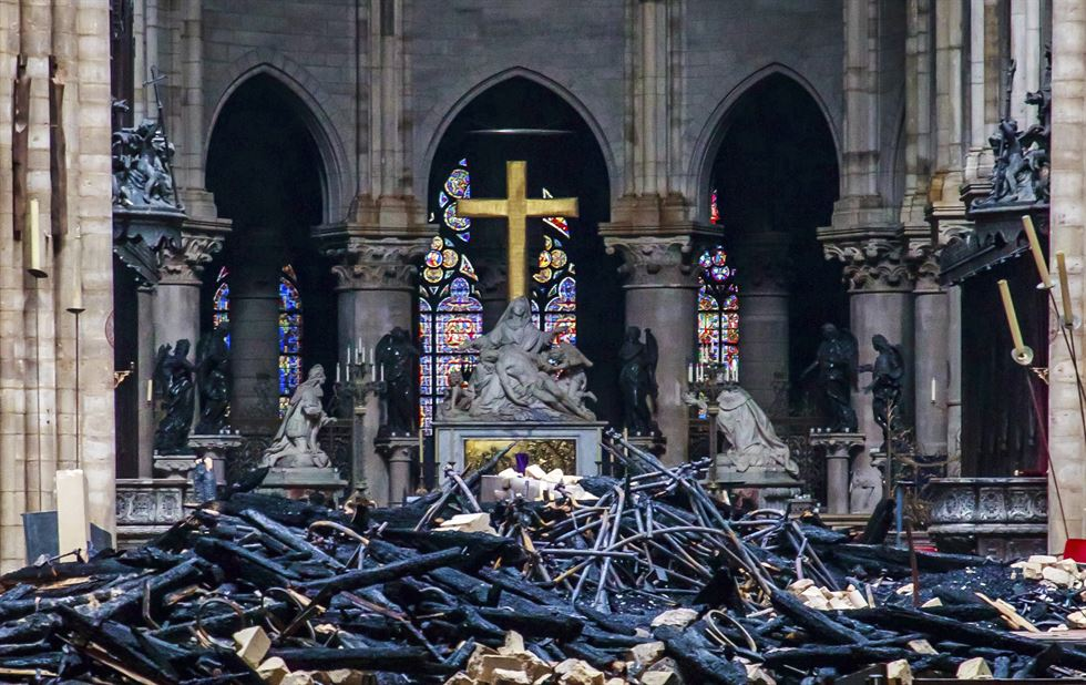 The steeple collapses as smoke and flames engulf the Notre Dame Cathedral in Paris on April 15. AFP