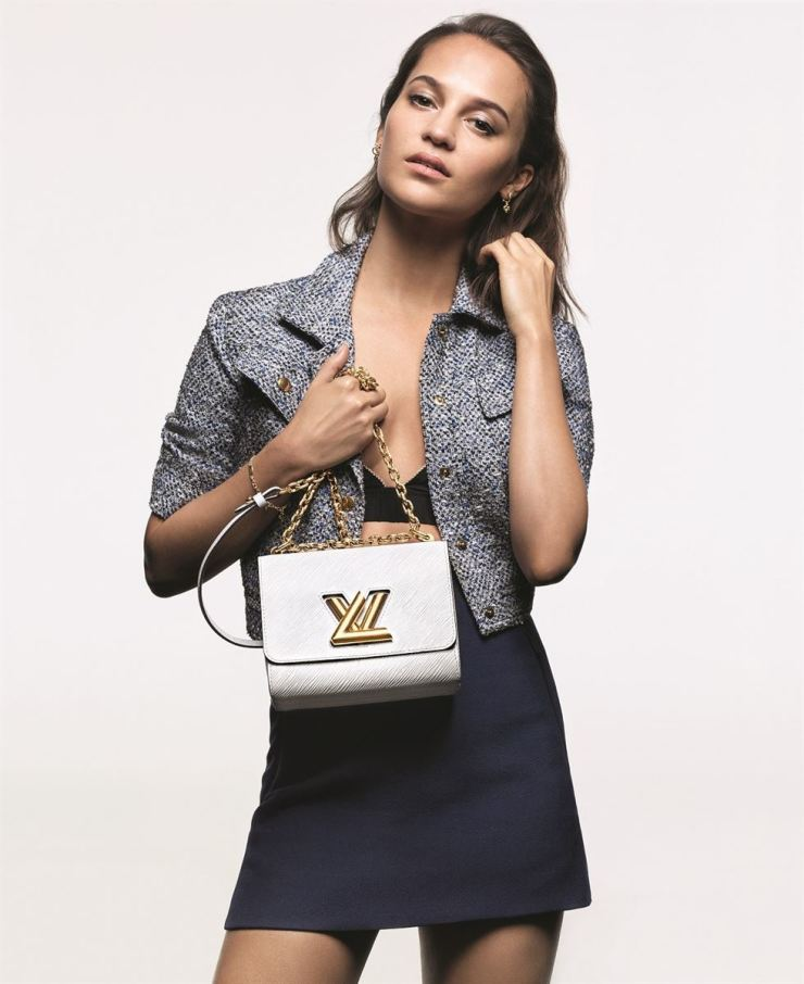 Alicia Vikander, a Louis Vuitton ambassador, poses with one of the New Classics bags as part of its most recent campaign. Courtesy of Louis Vuitton Korea