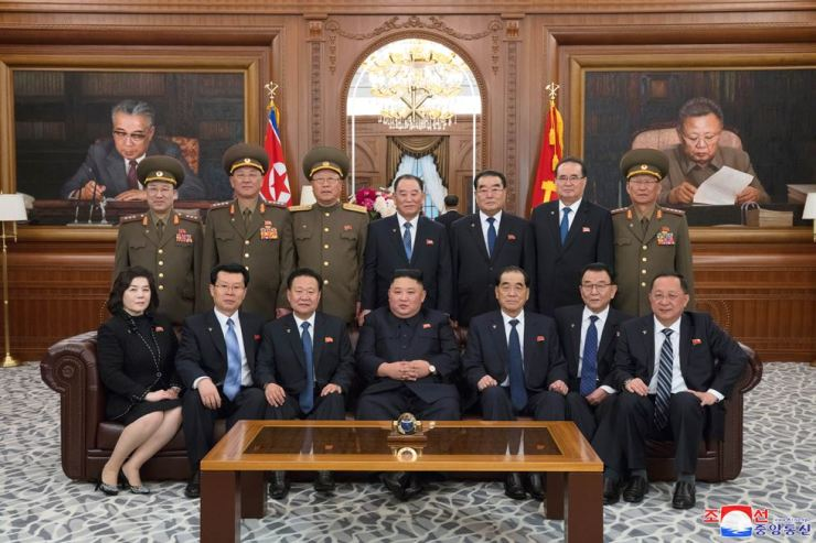 North Korean leader Kim Jong-un, center in the bottom line, poses with a group of the regime's newly elected ranking officials at headquarters of the Central Committee of the North's ruling Workers' Party in Pyongyang, Friday. Yonhap