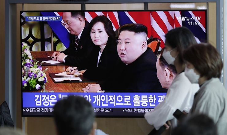 People watch a TV news program reporting about North Korea with file footage of North Korean leader Kim Jong-un, at the Seoul Railway Station in Seoul, South Korea, April 13, 2019. Yonhap