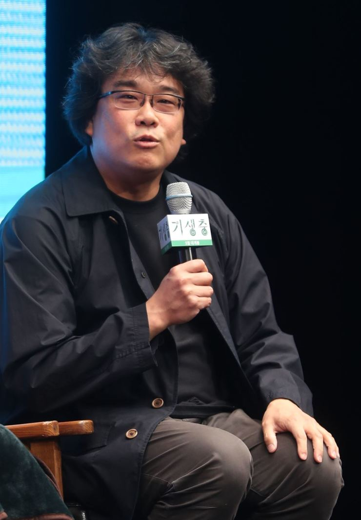 Director Bong Joon-ho speaks during a press conference for his upcoming film 'Parasite' at the Westin Chosun Seoul, Monday. The Cannes Film Festival recently announced the film was selected for the 2019 competition. / Yonhap