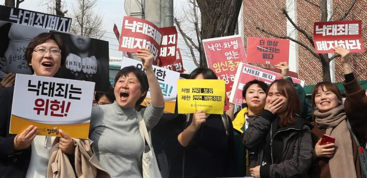 Anti-abortion ban activists celebrate outside of the Constitutional Court in Seoul, April 11, after the court ruled against the ban. / Yonhap
