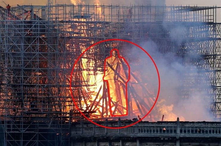 The apparent silhouette of a standing Jesus Christ is spotted in this image of the Notre Dame fire. Gettyimages