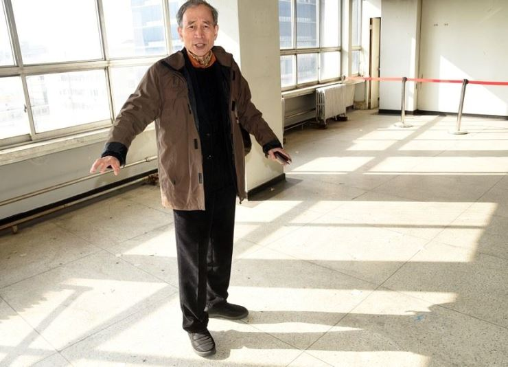 Gwangju International Center Director Shin Gyong-gu stands in a room on the top floor of the Jeonil Building, on which a military helicopter opened fire on reporters during the 1980 Gwangju Democratic Uprising. /Korea Times photo by Jon Dunbar