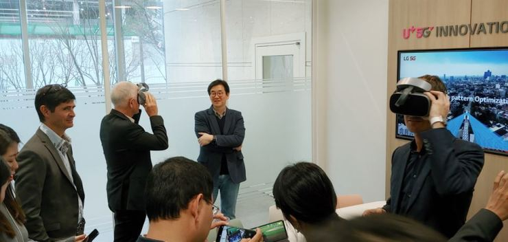 Key executives of South Africa's mobile operator Rain try on LG Uplus' 5G services at U+ 5G Innovation Lab in Magok, western Seoul, April 10. / Courtesy of LG Uplus