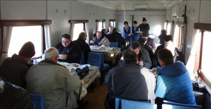Foreign tourists dine in the dining section of a train in North Korea in this photo revealed by North Korea's tourism website DPRKorea Tour, run by the North's National Tourism Administration. DPRKorea Tour-Yonhap