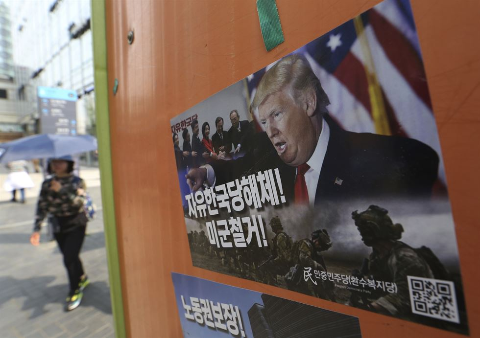 In this Feb. 2, 2018, file photo, U.S. President Donald Trump listens during a meeting with North Korean defectors where he talked with reporters about allowing the release of a secret memo on the FBI's role in the Russia inquiry. AP-Yonhap