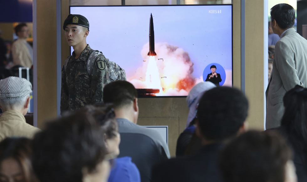 This Saturday, May 4, in a photo provided by the North Korean government May 5, shows North Korean leader Kim Jong-un, equipped with binoculars, observing tests of different weapons systems, in North Korea. AP-Yonhap