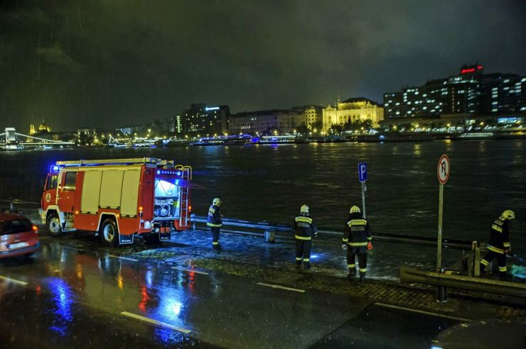 UPDATE Rescuers search for victims along the river bank early Thursday, after a tourist boat crashed with a river cruise boat, overturned and sank in River Danube in Budapest, Hungary, late Wednesday. AP