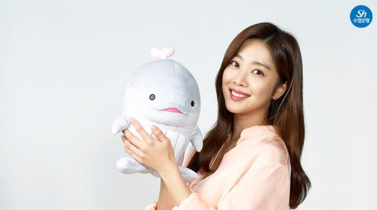 Cho Bo-ah poses with Suhyup Bank's whale character. Courtesy of Suhyup Bank