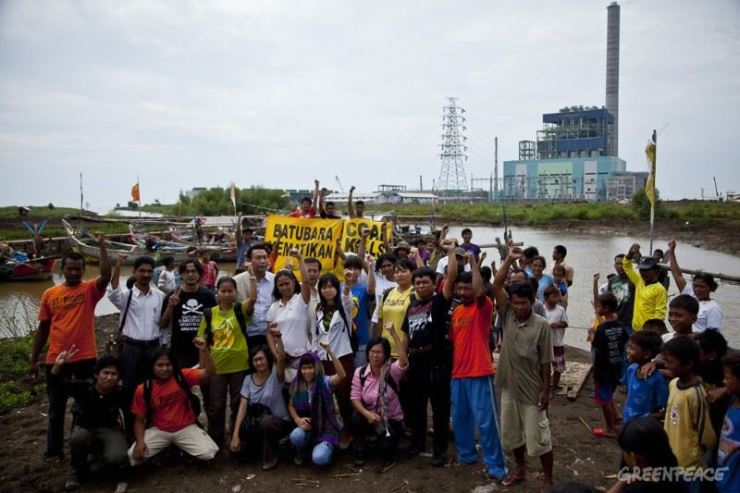 In this July 2010 file photo, Greenpeace members and other activists protest near the Cirebon 1 coal-fired power plant in West Java, Indonesia. Hyundai Engineering & Construction is building another coal-fired power plant in the area. Courtesy of Greenpeace