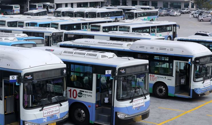 Buses are parked in a bus yard in Busan, Tuesday. Yonhap