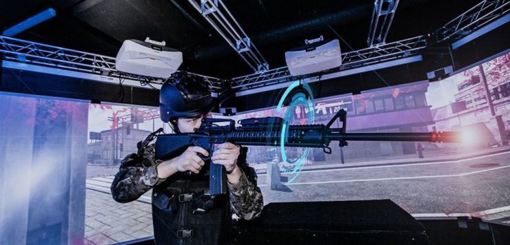 An Army cadet undergoes training with a virtual reality-based shooting simulator at the Korea Military Academy in Seoul on April 15. Yonhap