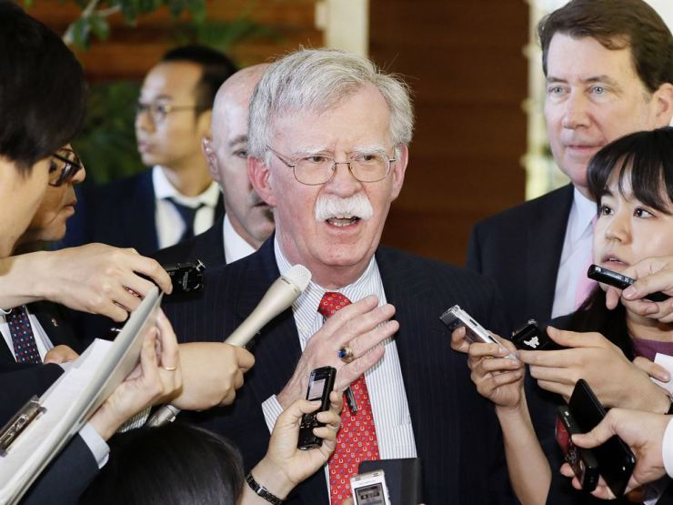 U.S. National Security Adviser John Bolton is surrounded by reporters at Japanese Prime Minister Shinzo Abe's official residence in Tokyo in this May 24, 2019 file photo. Bolton said a series of short-range missiles launched by North Korea last month were violations of U.N. Security Council resolutions, stressing the need to keep sanctions on the reclusive regime in place. The national security adviser reiterated that the U.S. position on the North's denuclearization was consistent and that a repeated pattern of failures should be stopped. (Yohei Kanasashi/Kyodo News via AP)