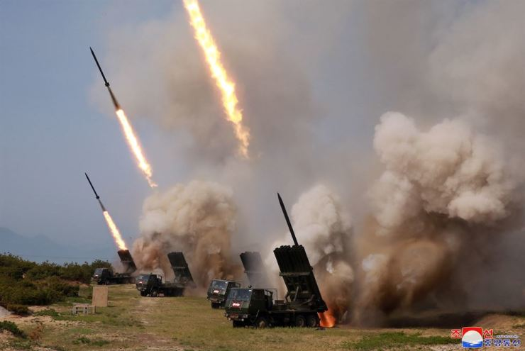 North Korean military conducts a live-fire drill for multiple launchers and tactical guided weapons in the country's east coastal city of Wonsan, Saturday. / Yonhap