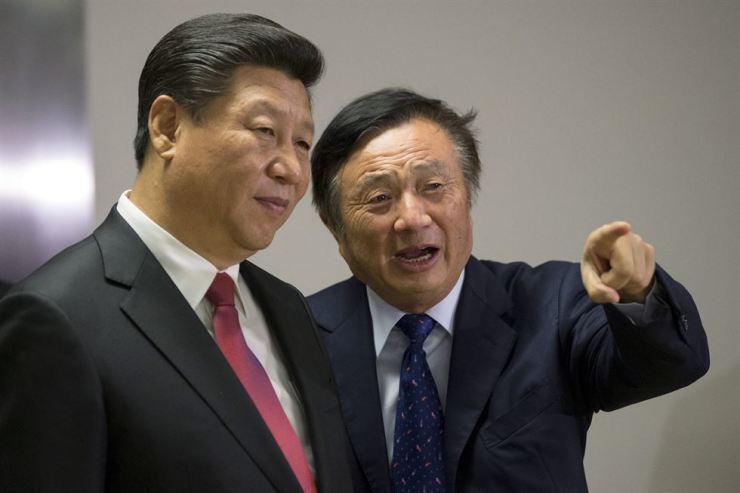 Chinese President Xi Jinping, left, pauses as Ren Zhengfei shows him around Huawei offices in London in 2015. Reuters