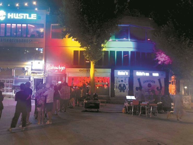 Revelers line up outside clubs Cakeshop and Contra in Itaewon to attend the Seoul Queer Culture Festival afterparty hosted by Shade x Femme last year. The clubs were lit in rainbow-colored lights on the night, representing the colors of the Pride flag.