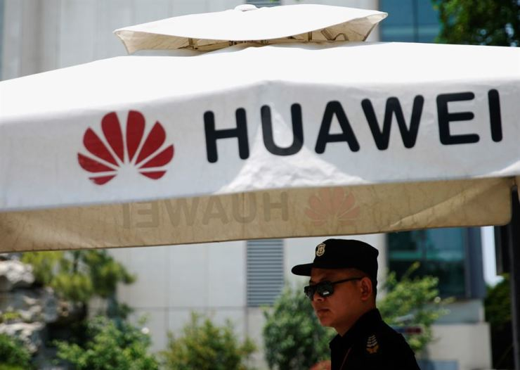 A Huawei company logo is seen at Huawei's Shanghai Research Center in Shanghai, China, May 22. Reuters