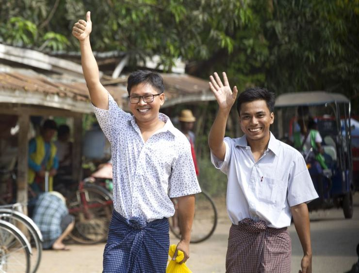 Reuters journalists Wa Lone, left, and Kyaw She Oo wave as they walk out from Insein Prison after being released in Yangon, Myanmar, May 7. AP