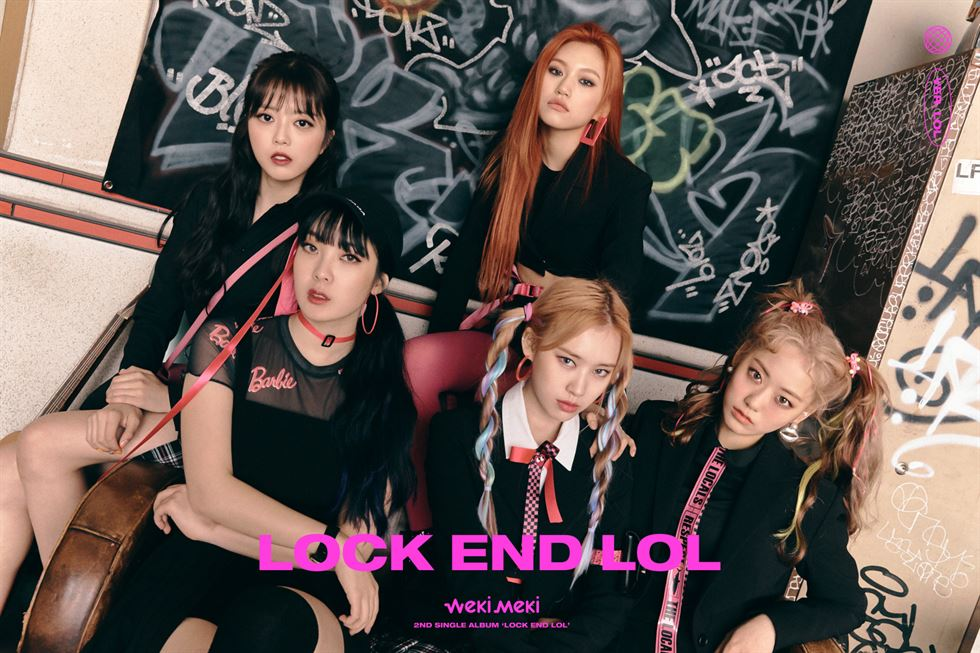 Weki Meki members pose for a 'locked' version of their characters, meaning they are 'locked' inside 'good girl' personalities.  Courtesy of Fantagio Corp.