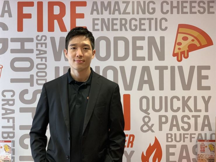 Lim Jae-won, founder and CEO of GOPIZZA, poses for a photo at a store branch in Sangsu-dong, Seoul, May 20. Courtesy of GOPIZZA
