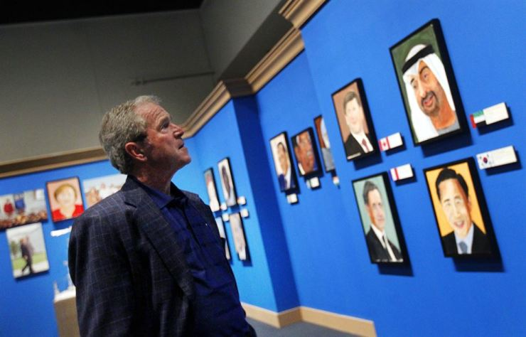 Portraits of world leaders are on display as part of 'The Art of Leadership: A President's Diplomacy' exhibition at the George W. Bush Presidential Library and Museum in Dallas, Texas, in this April 4, 2014 photo. AP-Yonhap file