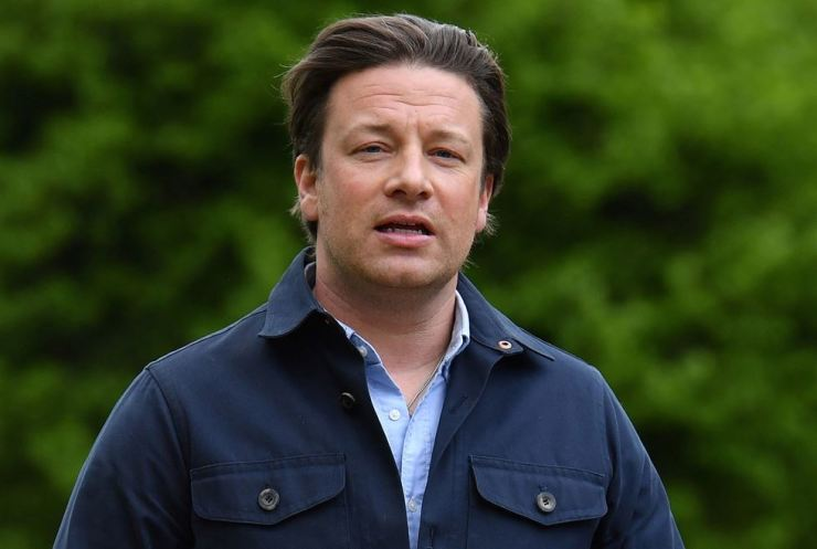 In this file photo taken on May 1, 2018, British chef Jamie Oliver arrives to speak to journalists after speaking on the subject of childhood obesity at Parliament's Health and Social Care Committee in London. The celebrity chef said that his restaurant group employing 1,300 staff had collapsed. AFP