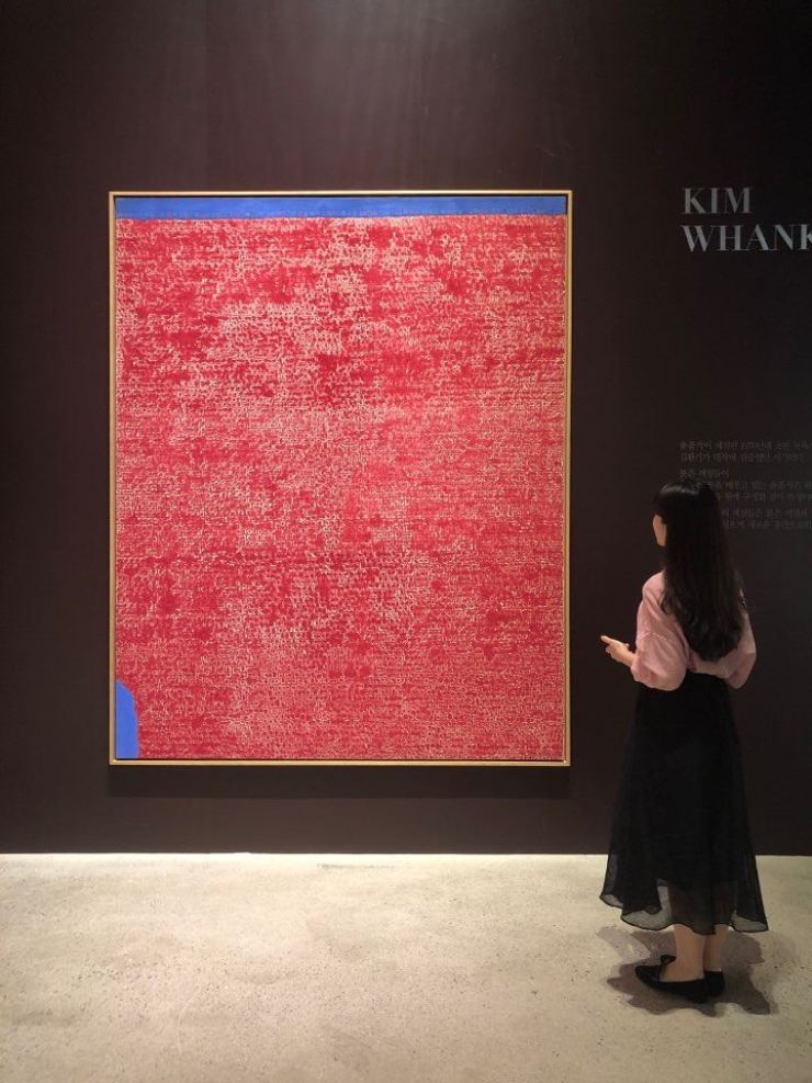 A visitor watches Kim Whan-ki's 1971 painting 'Untitled' during a preview ahead of Seoul Auction's 29th Hong Kong sale at Grand Hyatt Hong Kong. The painting fetched 7.2 billion won, becoming the second most expensive Korean artwork ever auctioned. Courtesy of Seoul Auction