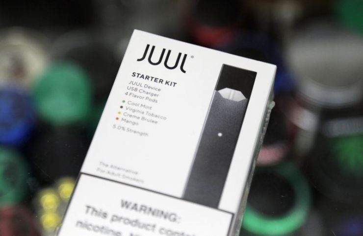 This Dec. 20, 2018, file photo shows a Juul electronic cigarette starter kit at a smoke shop in New York. AP