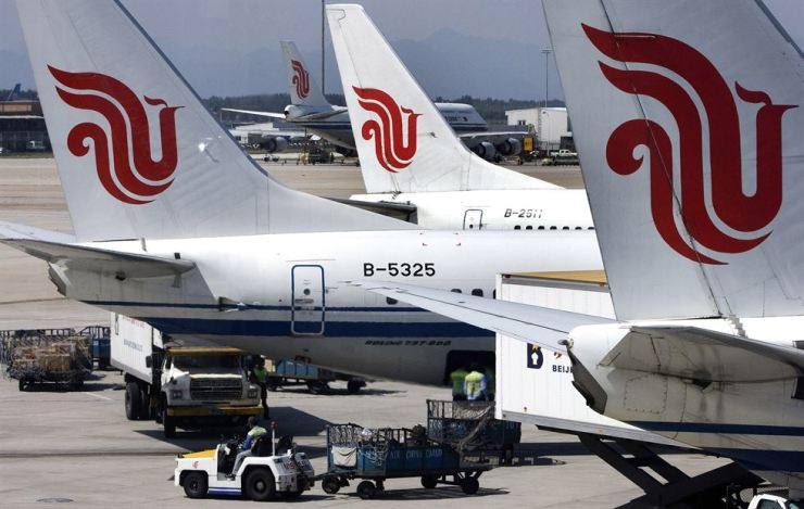 In this Aug. 29, 2007, file photo, Air China passenger airliners park at the Beijing International Airport in Beijing. Air China, one of China's three major state-owned airlines, is joining carriers that are asking Boeing for compensation for the grounding of their 737 Max jetliners following two fatal crashes. AP