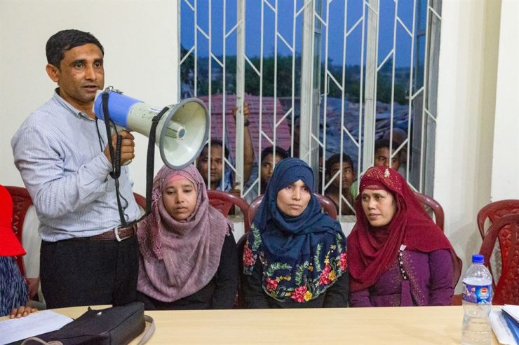 Mohib Ullah, left, a leader of Arakan Rohingya Society for Peace and Human Rights (ARSPH), speaks through a megaphone during an evening gathering between ARSPH members and a group of foreign journalists in Kutupalong camp in Cox's Bazar, Bangladesh, April 16. Courtesy of W-TIMES