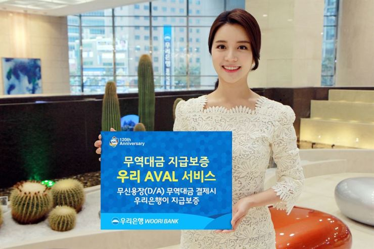 A model holds a sign promoting Woori AVAL service launched by Woori Bank, Sunday, Courtesy of Woori Bank