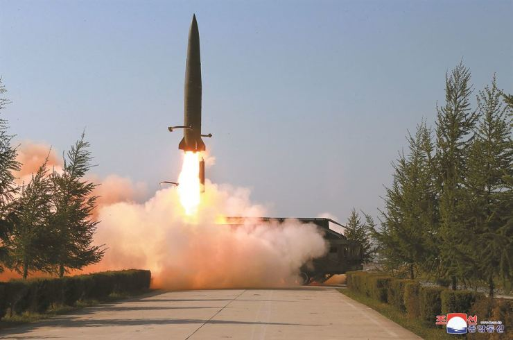 A suspected short-range missile is launched from Kusong, North Pyongan Province, in northwestern North Korea, Thursday, in this photo from the North's Korean Central News Agency (KCNA). North Korea fired what were presumed to be two short-range missiles into the sea off its east coast, with leader Kim Jong-un observing the launches. KCNA-Yonhap