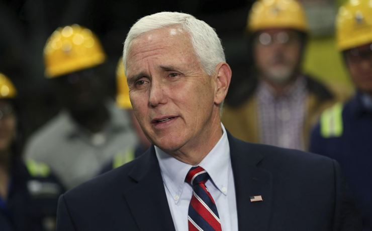 Vice President Mike Pence talks to reporters after speaking with steelworkers at the Gerdau Ameristeel mill in St. Paul, Minn., May 9, where he promoted the United States-Mexico-Canada trade agreement. AP-Yonhap