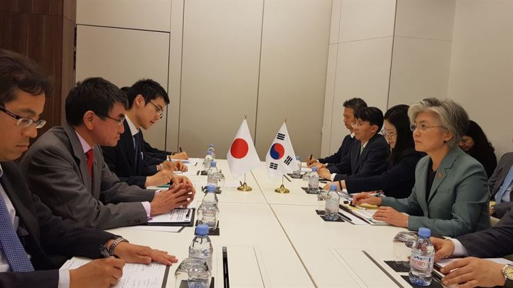 Foreign Minister Kang Kyung-wha, right, speaks during a meeting with her Japanese counterpart, Taro Kono, on the sidelines of the OECD Ministerial Council Meeting in Paris, Thursday. Yonhap