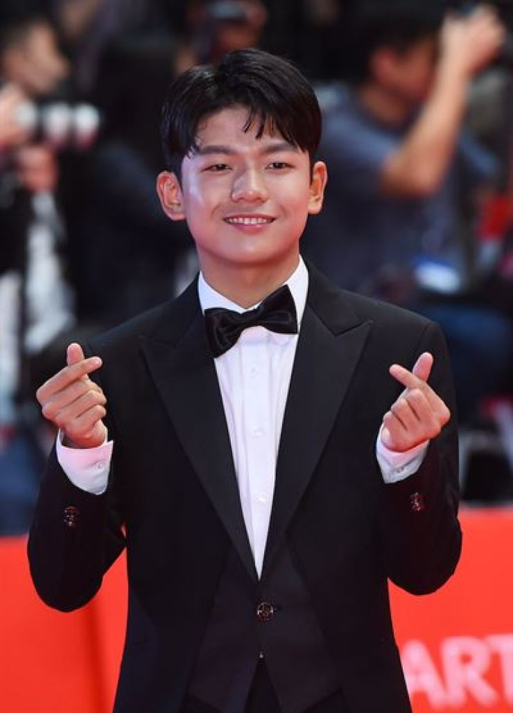 Wang Seok-hyeon on the red carpet at the Busan International Film Festival on Oct. 4, 2018. Korea Times file