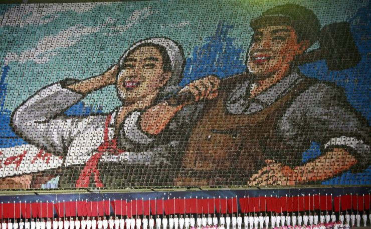 North Koreans hold cards to make an image depicting a worker and a farmer during a mass performance of 'The Land of the People' at the May Day Stadium in Pyongyang, North Korea, Tuesday. AP-Yonhap