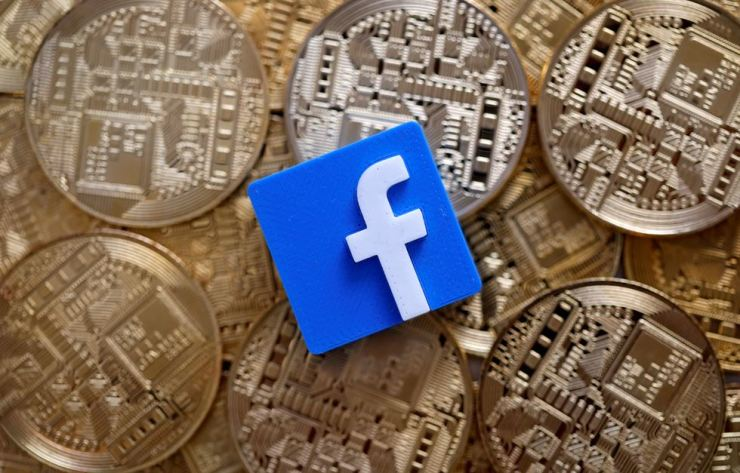 A 3-D printed Facebook logo is seen on representations of the Bitcoin virtual currency in this illustration picture, June 18. Reuters