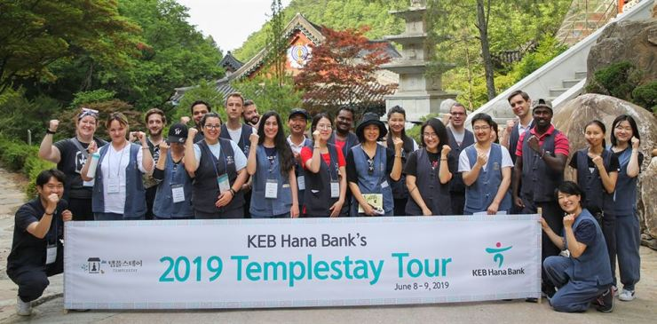 Foreign customers of KEB Hana Bank pose after taking part in a templestay program at Guin Temple in Danyang County, North Chungcheong Province, Sunday. The bank organizes the event every year to provide foreign customers an opportunity to learn about traditional Korean culture. / Courtesy of KEB Hana Bank