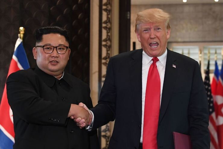 In this file photo taken on June 12, 2018, US President Donald Trump and North Korean leader Kim Jong-un shake hands following a signing ceremony during their historic US-North Korea summit, at the Capella Hotel on Sentosa Island in Singapore. AP-Yonhap