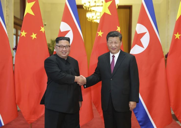 In this June 19 file photo released by China's Xinhua News Agency, Chinese President Xi Jinping, right, poses with North Korean leader Kim Jong-un for a photo during a welcome ceremony at the Great Hall of the People in Beijing. AP