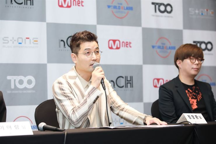 Jung Chang-hwan, left, head producer of Stone Music Entertainment, speaks during a news conference to launch a global idol group project at the Stanford Hotel Seoul, Wednesday./ Couretsy of Stone Music Entertainment