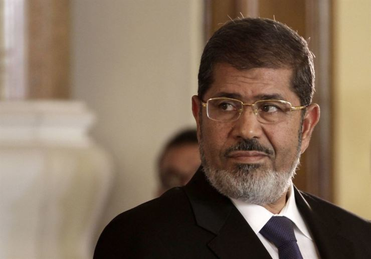 In this July 13, 2012, file photo, Egyptian President Mohammed Morsi holds a news conference with Tunisian President Moncef Marzouki at the presidential palace in Cairo, Egypt. Egypt's state TV said that the country's ousted leader collapsed during a court session and died. AP