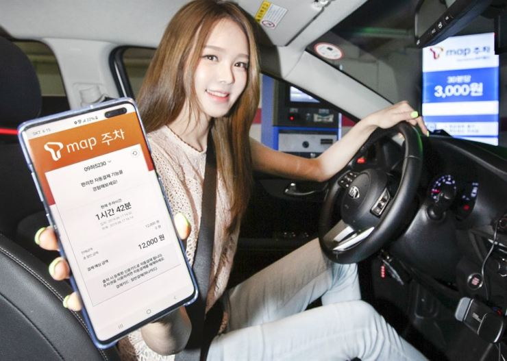 A model demonstrates SK Telecom's T map Parking app in this photo provided by the company, Wednesday. Courtesy of SK Telecom