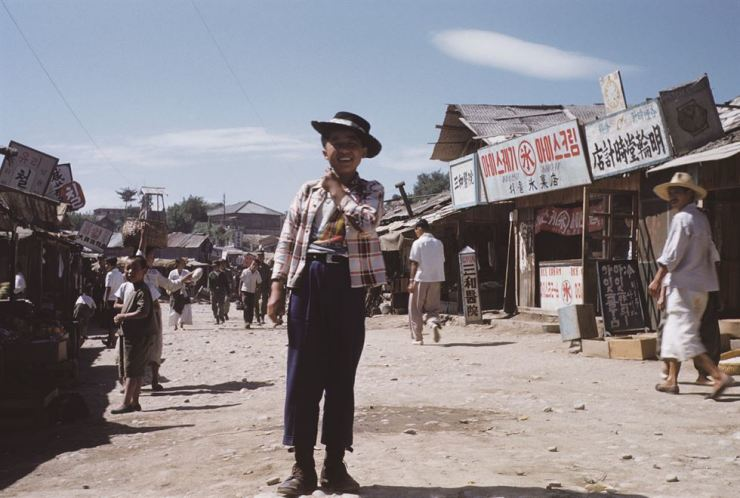 A 'houseboy' in cowboy clothes poses in Chuncheon, Gangwon Province in this 1953 photo. Houseboys cleaned the tent and washed clothes for U.S. soldiers at the U.S. military camp and in return they were provided with food, pocket money and a warm place to sleep. / Photos from Noonbit Publishing