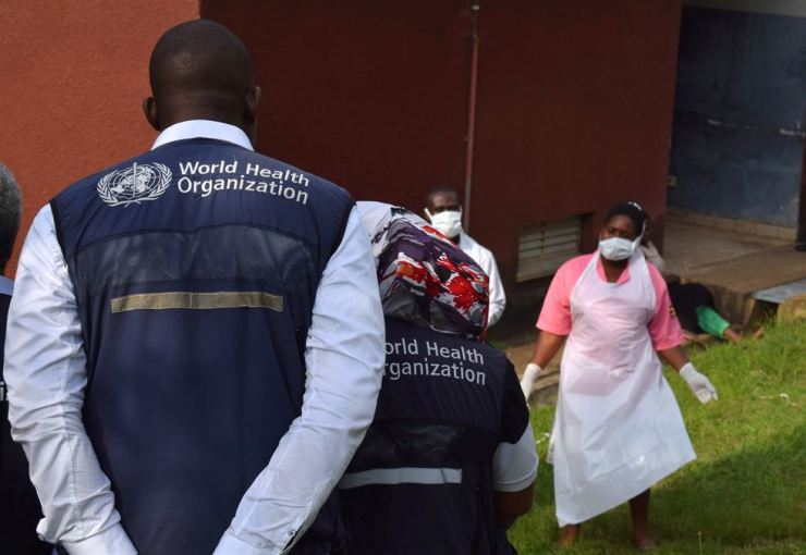 World Health Organization officials talk to Ugandan medical staff as they inspect ebola preparedness facilities at the Bwera general hospital near the border with the Democratic Republic of Congo in Bwera, Uganda, June 12. Reuters